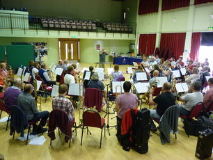 Respected musical conductor leads local wind band