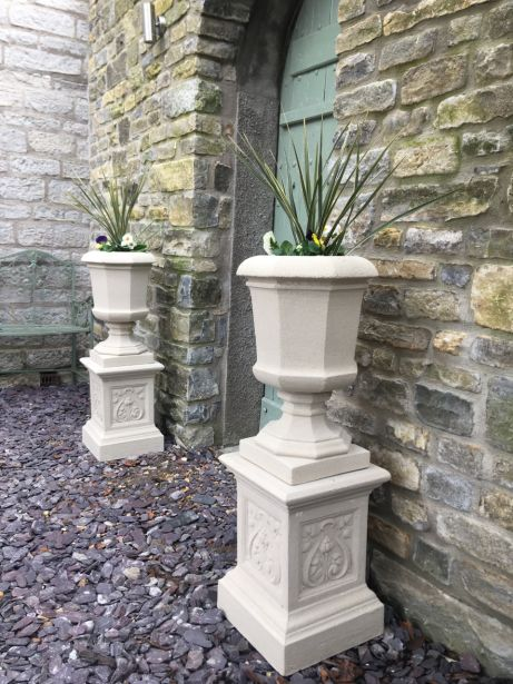 Baldwin Urns on French Plinths