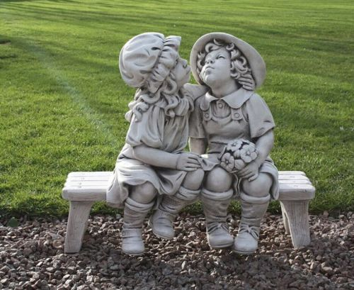 Boy and Girl Kissing Sat on Bench