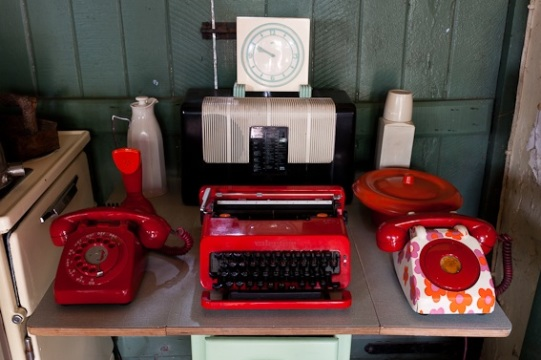Display of Bakelite typewriter and telephones, image supplied by Bakelite museum