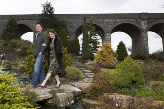 Couple walking in Kilver Court Secret Garden by Colin Hawkins for Visit Somerset